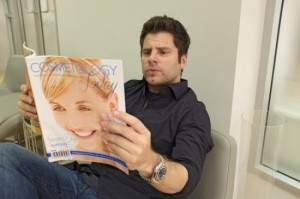 Shawn reading a magazine at the plastic surgery office