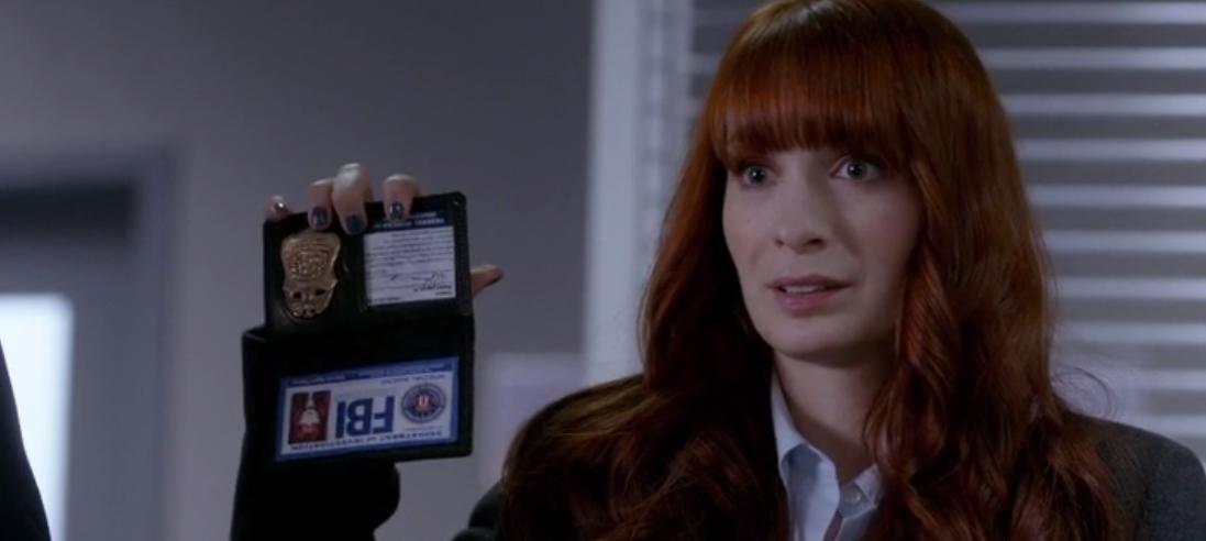 Supernatural-s8-ep20-Charlie-holding-her-badge-upside-down
